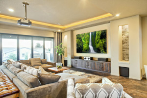 home cinema room with projector and speaker set